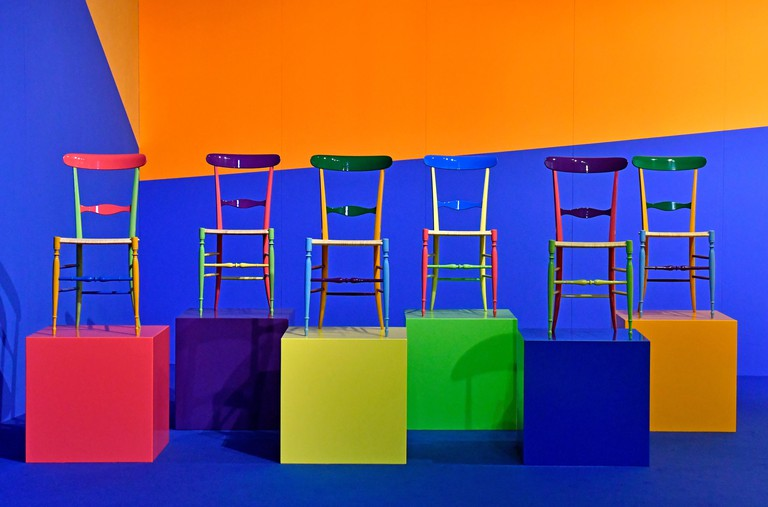 Colorful chairs displayed at the International design week Salone del Mobile, in Milan, Italy.