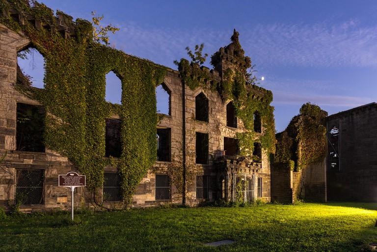 Abandoned Smallpox Hospital  ruins on Roosevelt Island illuminated at twilight. New York City