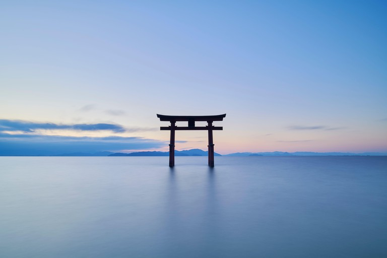 Long exposure shot of Shirahige shrine Torii gate at sunrise, Lake Biwa, Shiga Prefecture, Japan