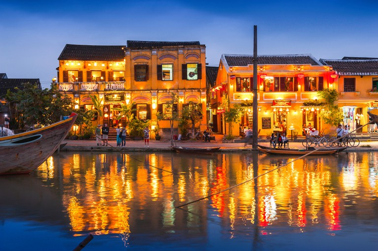 Hoi An Vietnam, view at night of illuminated riverside bars and restaurants in the historic Old Town tourist quarter of Hoi An, Central Vietnam.