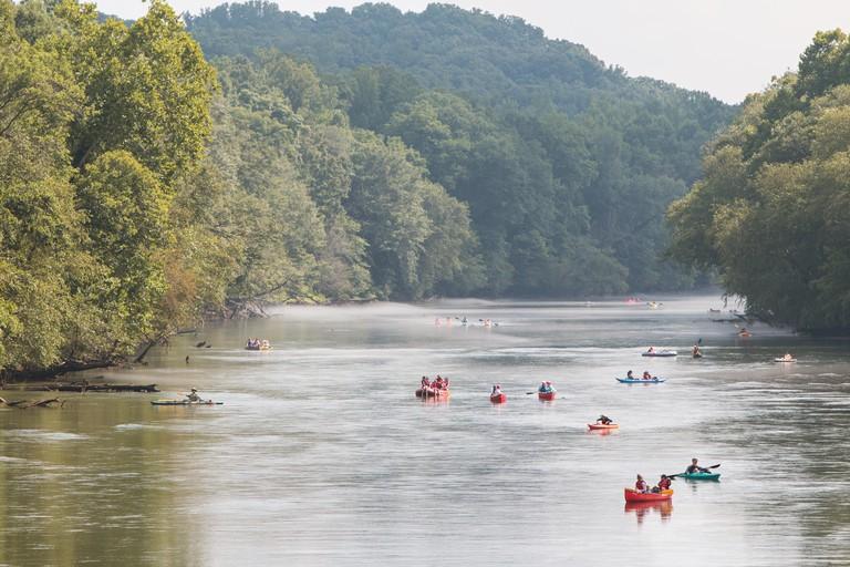 Atlanta, GA, USA - July 25, 2015:  People raft, kayak and canoe down the  Chattahoochee River on a hot summer day on July 25, 2015 in Atlanta, GA.