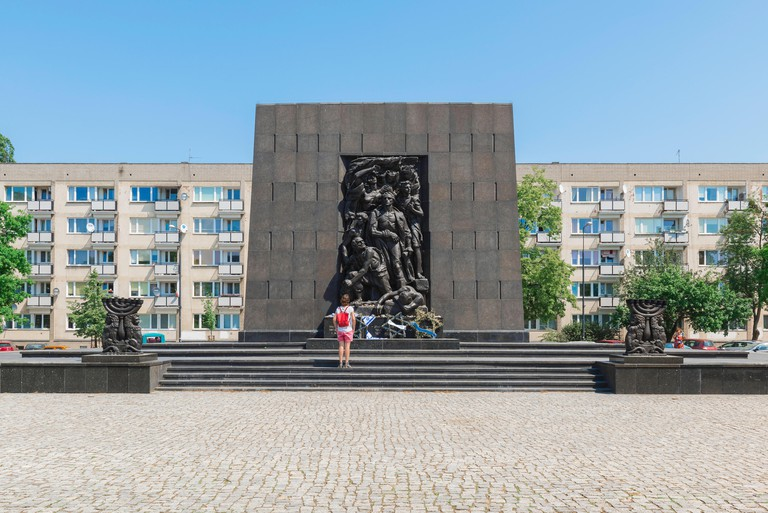 Ghetto Heroes Monument, view of a young woman visiting the Ghetto Heroes Monument which commemorates the Warsaw Jewish Ghetto Uprising of 1943, Poland