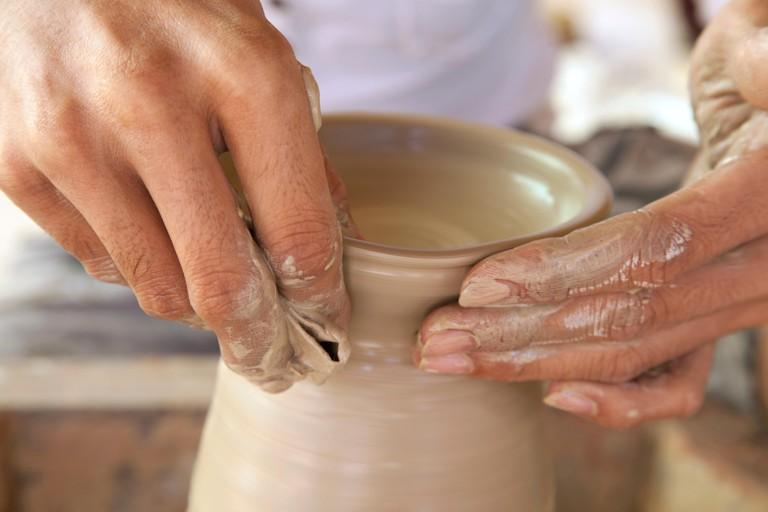 PFR284 Cambodia, Siem Reap, Khmer Ceramics Centre, artisan making a ceramic piece