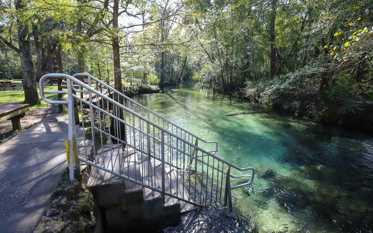 PONCE DE LEON, FLORIDA, UNITED STATES - Oct 18, 2018: A short flight of stairs descends into the Spring Run at Ponce De Leon Springs State Recreation