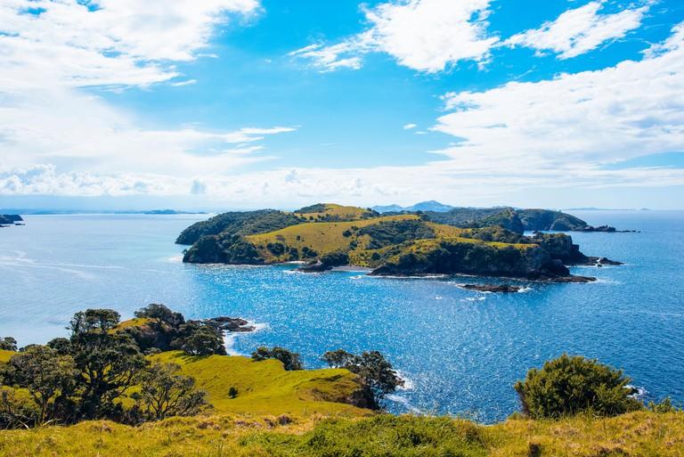 Looking northwest from Urupukapuka Island in the Bay of Islands, North Island, New Zealand towards Waewaetorea Island and distant Purerua Peninsula_M7A607