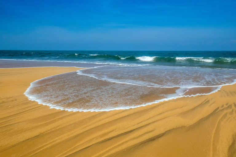 amazing beach and draws in the sand in Arugam bay, Sri lanka