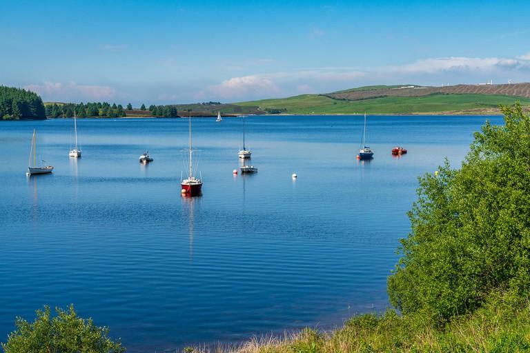 Near Cerrigydrudion, Conwy, Clwyd, Wales, UK - June 09, 2018: Boats on Llyn Brenig