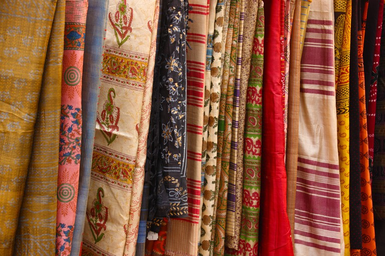 Saris hanging in a clothing store, Dilli Haat, New Delhi, India