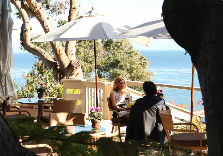 USA, California, Malibu, outdoor seating at the infamous designer restaurant, Geoffrey's