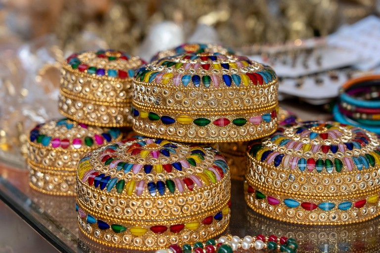Colorful jewel boxes in Indian market on the street in Rishikesh, India. Close up.