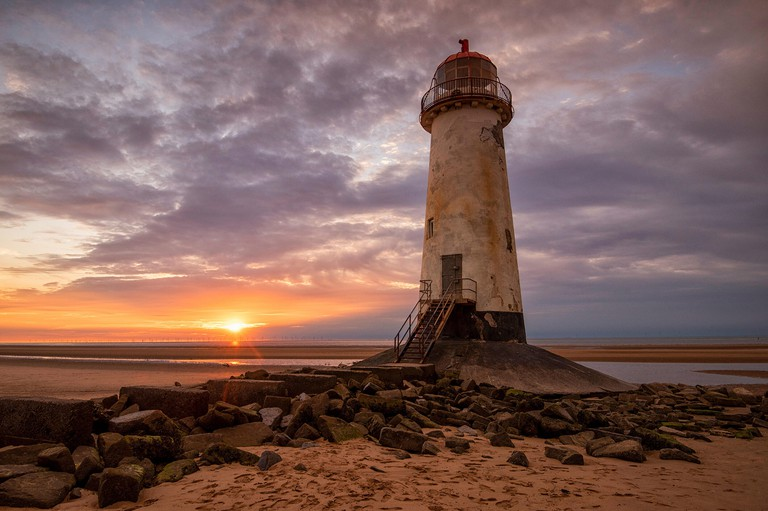Sunset at the Point of Ayr Lighthouse at Talacre Beach, Prestatyn North Wales UK