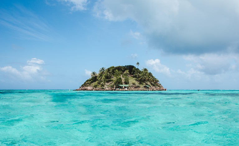 Intense turquoise water around Crab Cay, a small rock off Isla de Providencia, one of Colombia's paradise Caribbean islands