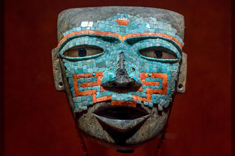 July 24, 2019: Aztec mask covered with jade at The National Museum Of Anthropology.  Mexico City