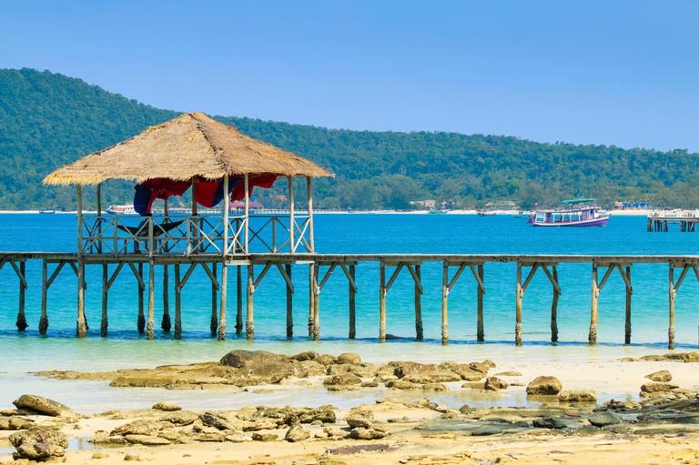 Pier at this holiday island's beautiful white sand beach; Saracen Bay Resort, Koh Rong Sanloem Island, Sihanoukville, Cambodia