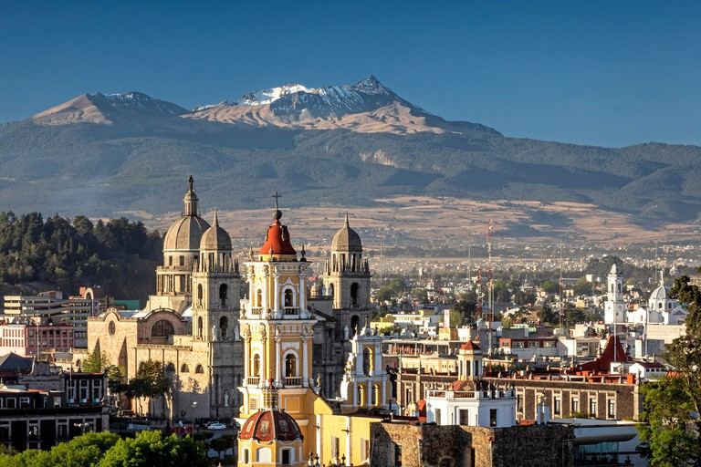 The Nevado de Toluca mountain rises up above the historic downtown of Toluca, Mexico.