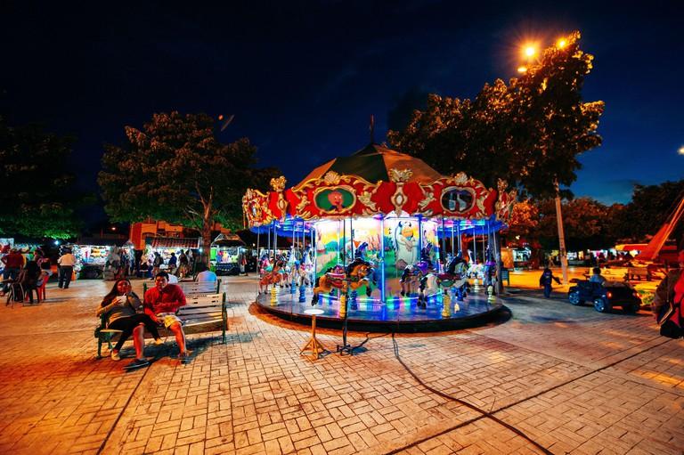 Parque de las Palapas, cancun, mexico - june, 2019 square carousel