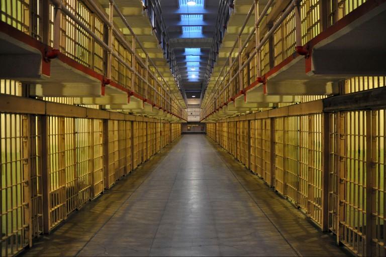 Inside the Alcatraz Prison at dusk.