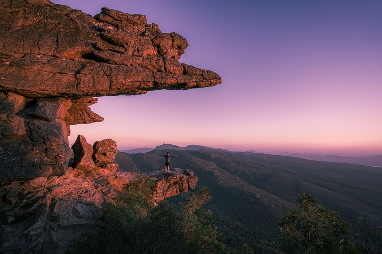 A guy standing on reeds lookout in the Grampians national park, Australia