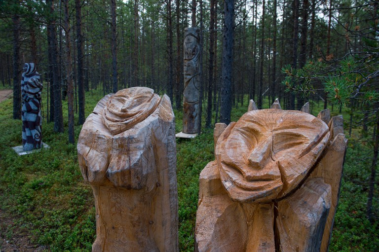 Wooden sculptures displayed outdoors at the Siida Museum in Inari, which is the national museum of the Sami People in Lapland, northern Finland