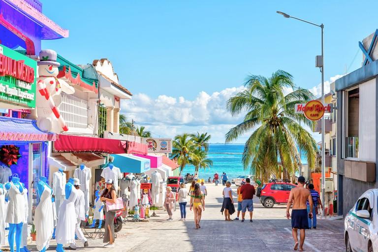 PLAYA DEL CARMEN, MEXICO - DEC. 26, 2019: Visitors enjoy shopping on the famous entertainment district of Playa del Carmen beach in the Yucatan penins