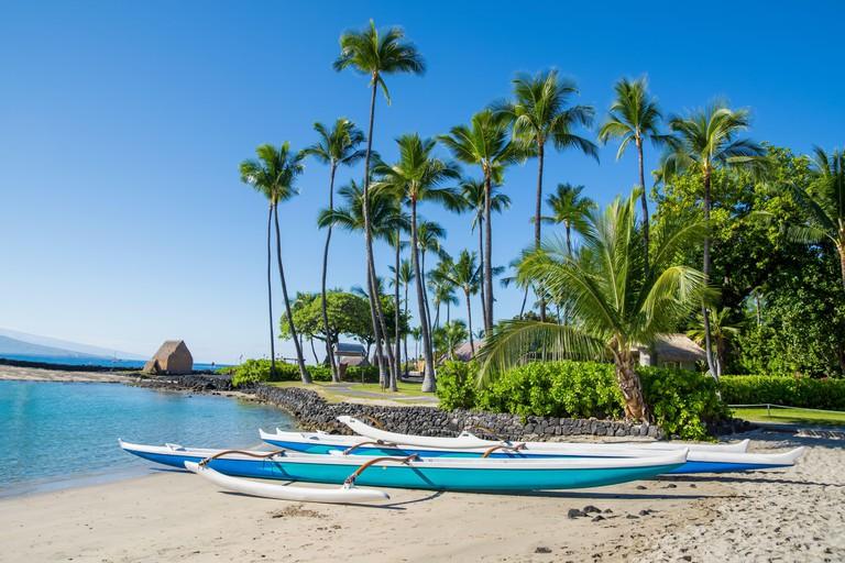Hawaiian outrigger canoe at Kamakahonu Beach Kailua-Kona, Big Island, Hawaii