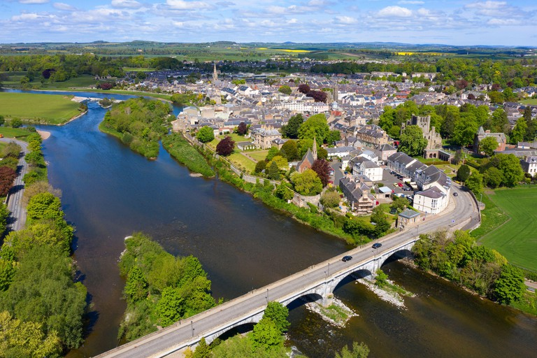 Aerial view of town of Kelso during Covid-19 lockdown beside River Tweed in Scottish Borders, Scotland, UK