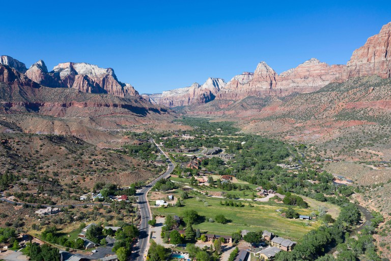 Aerial views above Springdale, Utah set in a dramatic landscape at the entrance to Zion National Park