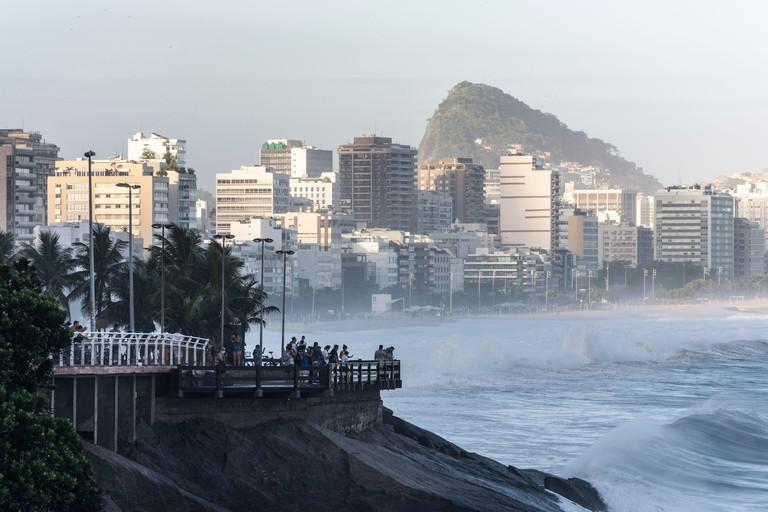 Beautiful view to people enjoying the ocean view from Mirante do Leblon, Rio de Janeiro, Brazil