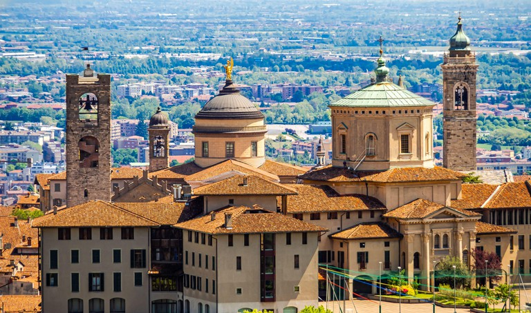 High angle view of the churches and main buildings of Bergamo Alta, historic district of Bergamo, Italy - 09/05/2019