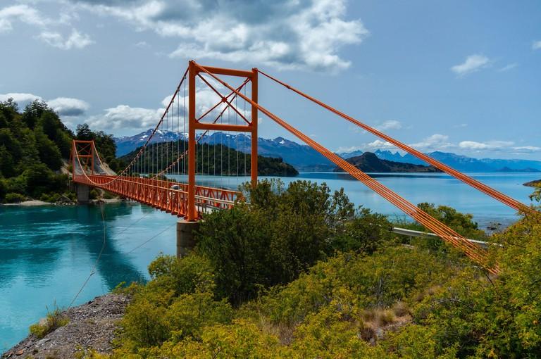 Carretera Austral red bridge over Glacial lake in Patagonia