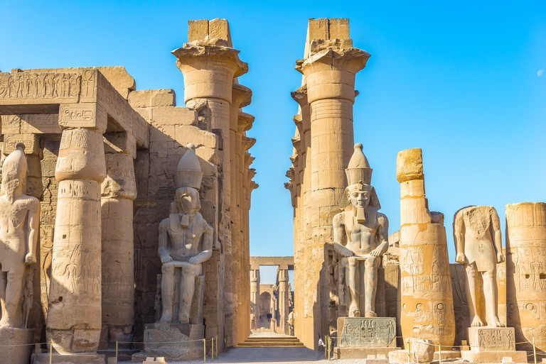 Sitting statues in Luxor Temple at sunny morning