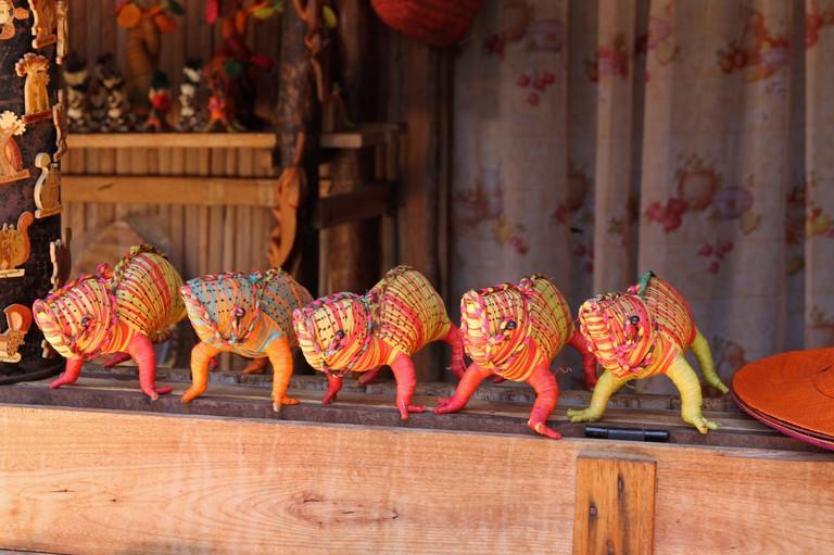 Wire chameleon animal souvenirs for sale, Ampangorinana Village, Nosy Komba Island, Madagascar.
