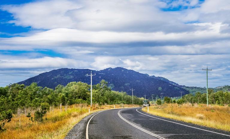 the distinctive black boulder hills of Black Mountain National Park seen from Mulligan Highway, Shire of Cook, Far North Queensland, Australia