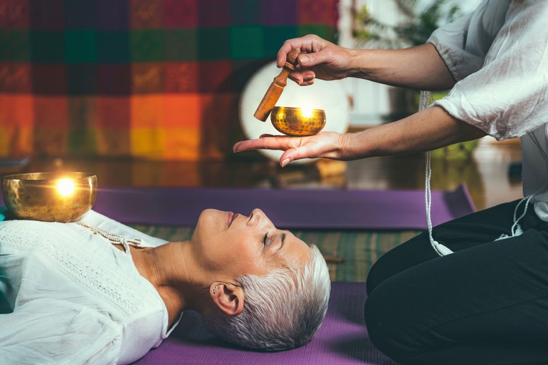 Tibetan singing bowl in sound meditation therapy.