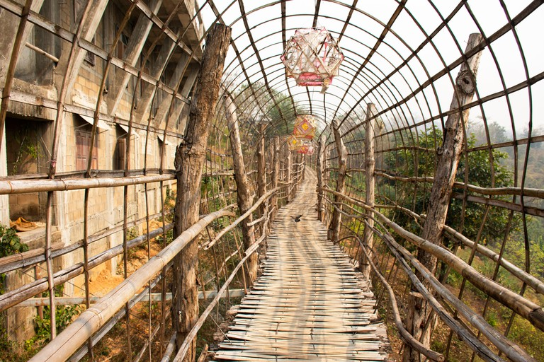 Su Tong Pae bamboo wooden bridge of Wat Phu Sa Ma temple for thai people and foreign traveler travel visit while PM 2.5 Dust situation in Ban Kung Mai