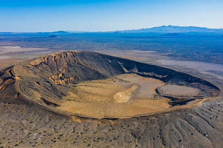 Aerial view of the maar-type volcanic crater, cater Cerro Colorado in the mountains of the El Pinacate Biosphere Reserve and the great Altar desert in