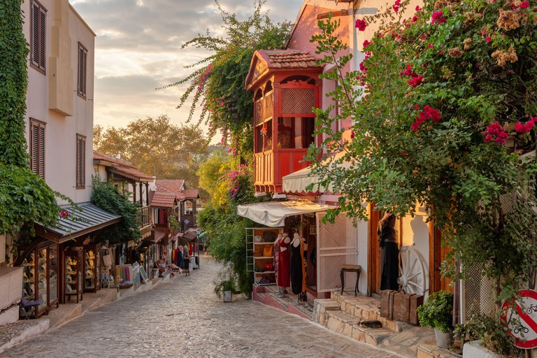 Beautiful street in the Kas old town with boutique shops at sunset, Turkey