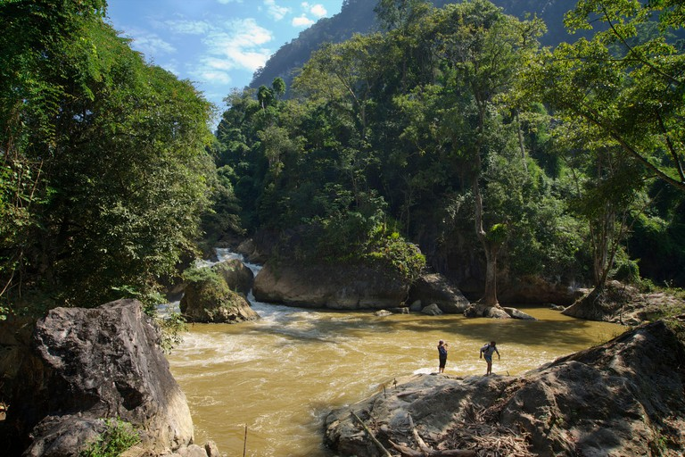 European tourists climbing on the rocks downstream of Dau Dang Waterfall, Ba Be National Park, Northeast Vietnam. MODEL RELEASED