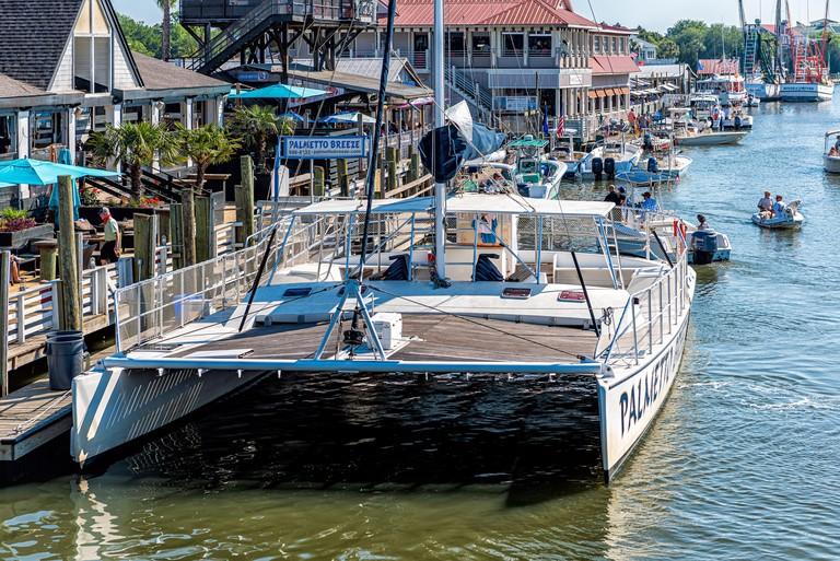 Mount Pleasant, USA - May 11, 2018: Charleston South Carolina SC area with restaurants on bay Shem Creek and Palmetto Breeze boat