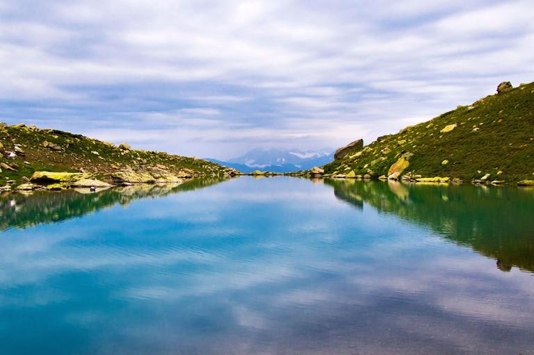 Alpine mountain lake landscape, colorful nature view, Georgian lake, travel destination, hiking place.
