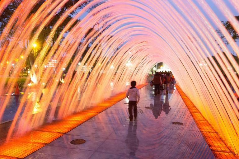 Visitors run through the water at The Magic Water Circuit Park (Circuito Magico del Agua)