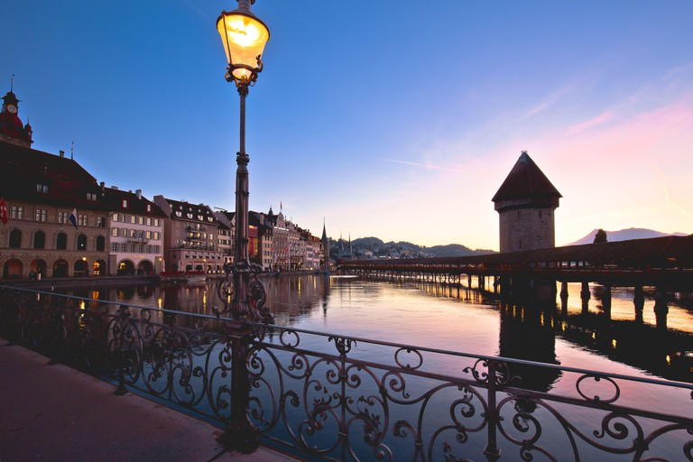 Luzern riverfront and wooden Chapel Bridge and tower view, town in central Switzerland