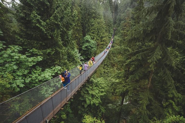 Vancouver, Canada - June 2 2017: Tourists enjoy a visit to the Capilano Suspension Bridge Park in North Vancouver, B.C. Canada