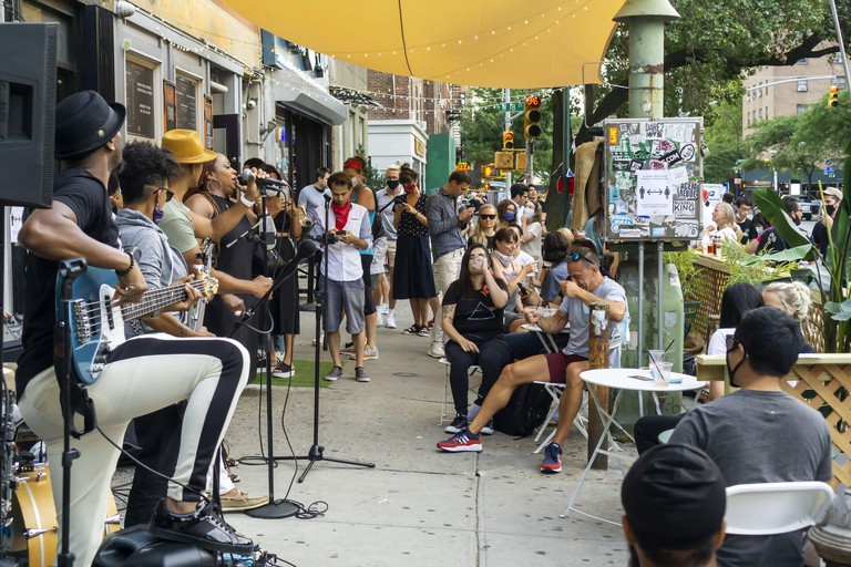 Crowds of people congregate outside of Bathtub Gin in the Chelsea neighborhood of New York as the bar celebrates its 9th anniversary with a party on Thursday, July 16, 2020. NYS Gov. Andrew Cuomo will announce plans for the city to enter Phase 4 of its re