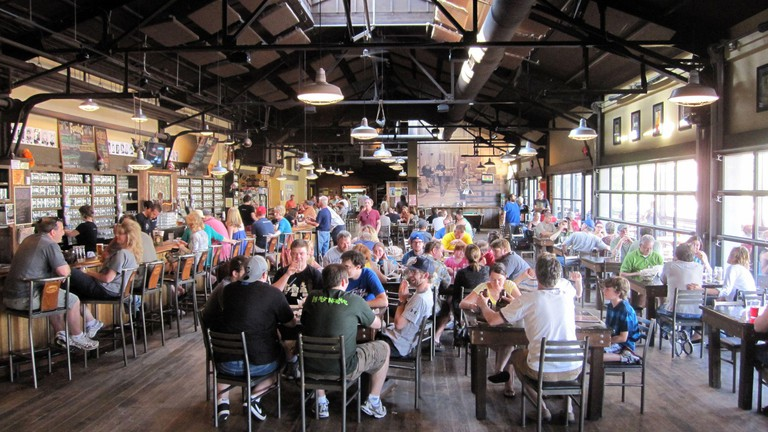 Founders Brewing in Grand Rapids, Michigan, is the city's big daddy of brewing, both in terms of production and popularity. Ita??s housed in a former warehouse with a wall of windows and skylights above the long, sloping wood bar. (Photo by Josh Noel/Chic