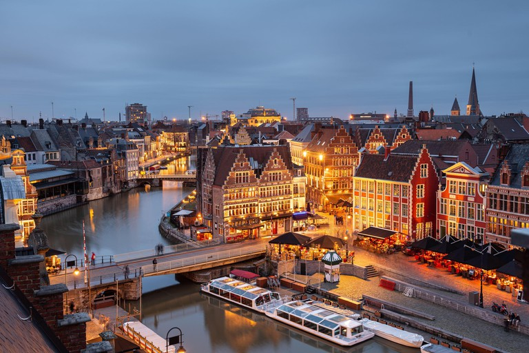 Ghent, Belgium old town cityscape over the Graslei are at dusk.