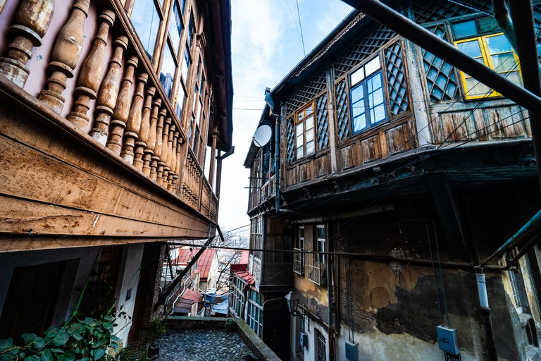 Old Tbilisi with narrow street and red roofs