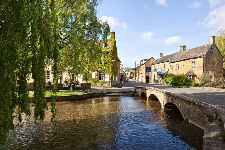 Beside the River Windrush in the Cotswold village of Bourton on the Water, Gloucestershire UK