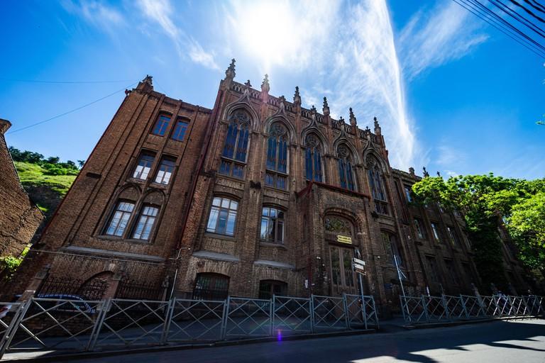 07 MAY 2021, TBILISI, GEORGIA: Famous gothic school on Asatiati street in Sololaki area in Old Tbilisi, Georgia