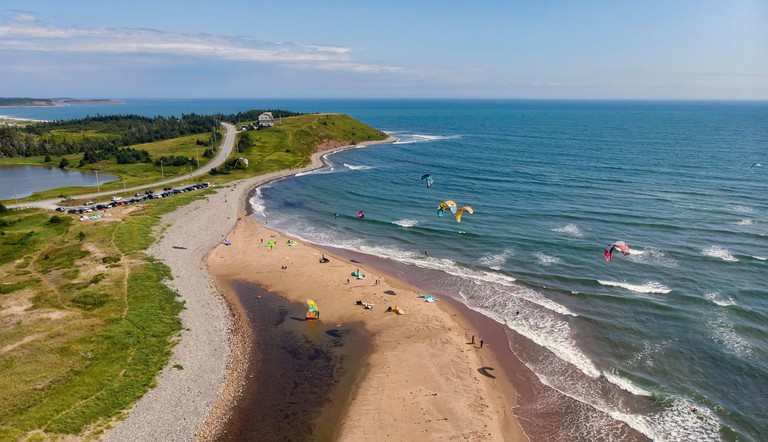 Aerial view of kiteboarders at Lawrencetown Beach in Nova Scotia on a sunny day.
